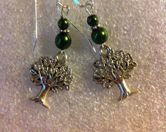 Tree of life pierced earrings with dark emerald green luster beads.