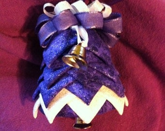 Purple and silver glittery fabric bell ornament.