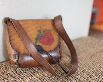 vintage 1970's tooled apple leather handbag