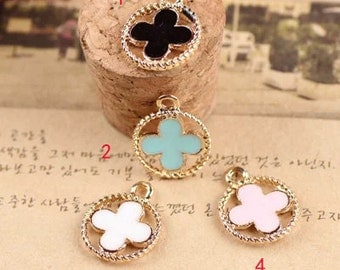 10 pcs of antique gold color clover hollow out badge drop oil charm pendants 15x12mm