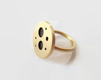 Handmade brass ring with oxidized holes.