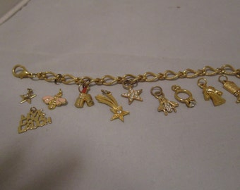 Gold Tone Charm Bracelet with 10 Charms