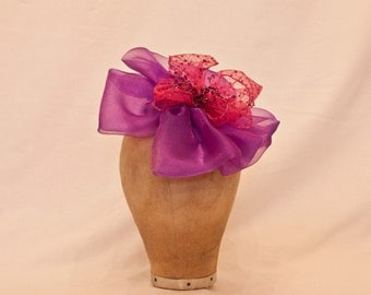Cute pink and purple ladies hat/fascinator with beading detail.