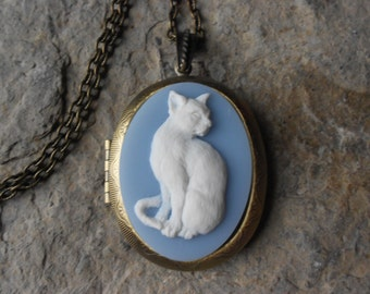 "CAMEO LOCKET-- White Cat on Wedgewood Blue Cameo Locket Necklace -  2"" long -  Bronze - Antique Look - Great Quality!!"