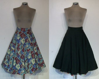 Great early 1950s rayon print / black cotton reversible full skirt waist 26""