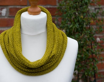 This cowl is my Happy Cowl - a luxurious hand knit cowl made with beautiful artisan dyed merino, silk and yak yarn in a golden green shade