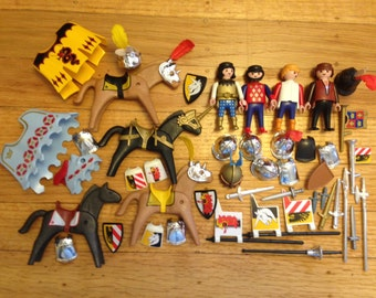 Playmobil medieval knights and horses -- and all of their tournament gear