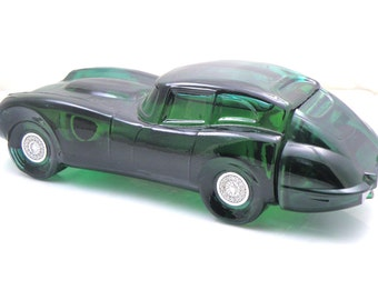 Green Avon bottle Jaguar sports car! Canadian Customers also get the 5 fluid ounces Avon Wild Country aftershave. US, bottle only.