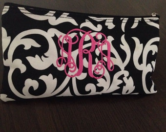 One 10inch black and white damask zipper cosmetic bag with pink intervined monogram