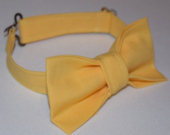 Adjustable yellow bow tie for baby boy. Marigold yellow bow tie for infant, toddler, and boys. Perfect for pictures, weddings, birthdays