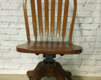 Rolling wooden secretaries chair antique