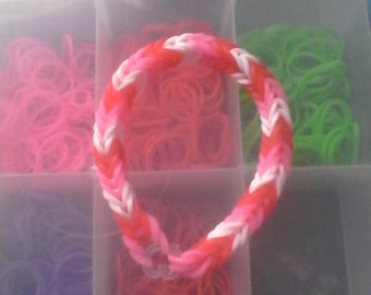 Red white and pink rubber band bracelet