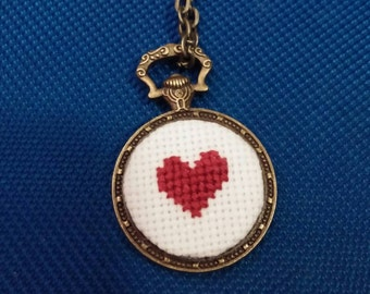 Red heart cross stitch necklace in bronze pendant