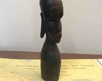 African wood head carving