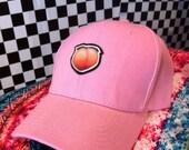 Peach emoji cap
