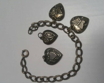Old sterling puffy heart charm bracelet and charms