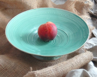 Handmade emerald green and tan pedestal bowl