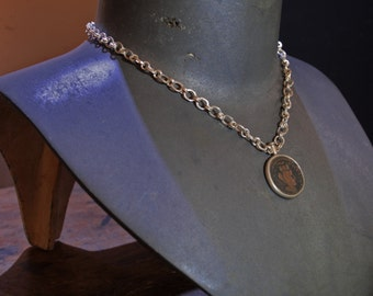 Silver necklace with ancient coin