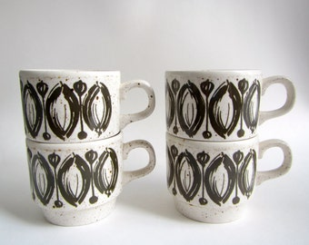 set of four olive and white Biltons England stackable mugs