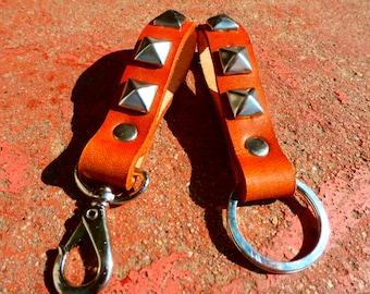 Handmade leather keychain in horizon tan with pyramid studs