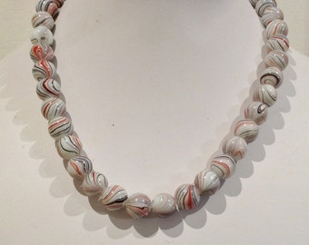 Necklace 40cm Features 10mm rouynd Enamelled Glass beads White with orange/red and black swirly patterns
