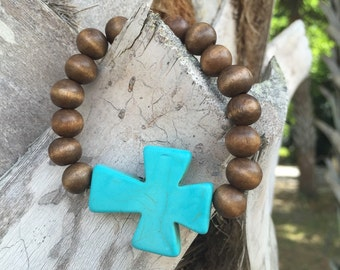 Turquoise Cross on brown wooden beads