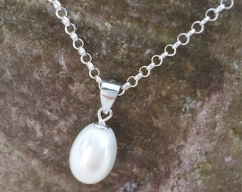 Fresh water pearl with silver necklace.