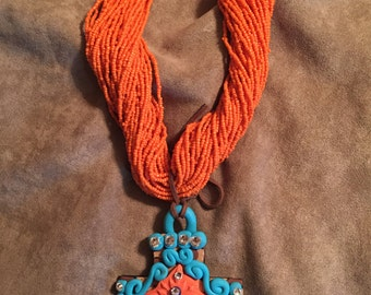 Multi-strand seed bead necklace with polymer clay pendant