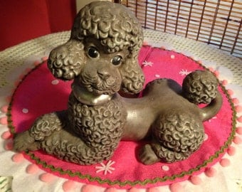 Pretty and proper vintage gray poodle