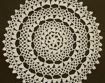 Beige round crochet doily