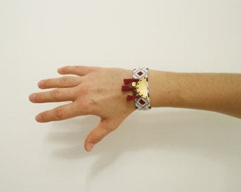 AVA cuff in woven cotton with metal piece and pompons / pastel blue and plum purple