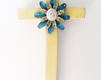 Rustic yellow wooden cross with metal and burlap flower