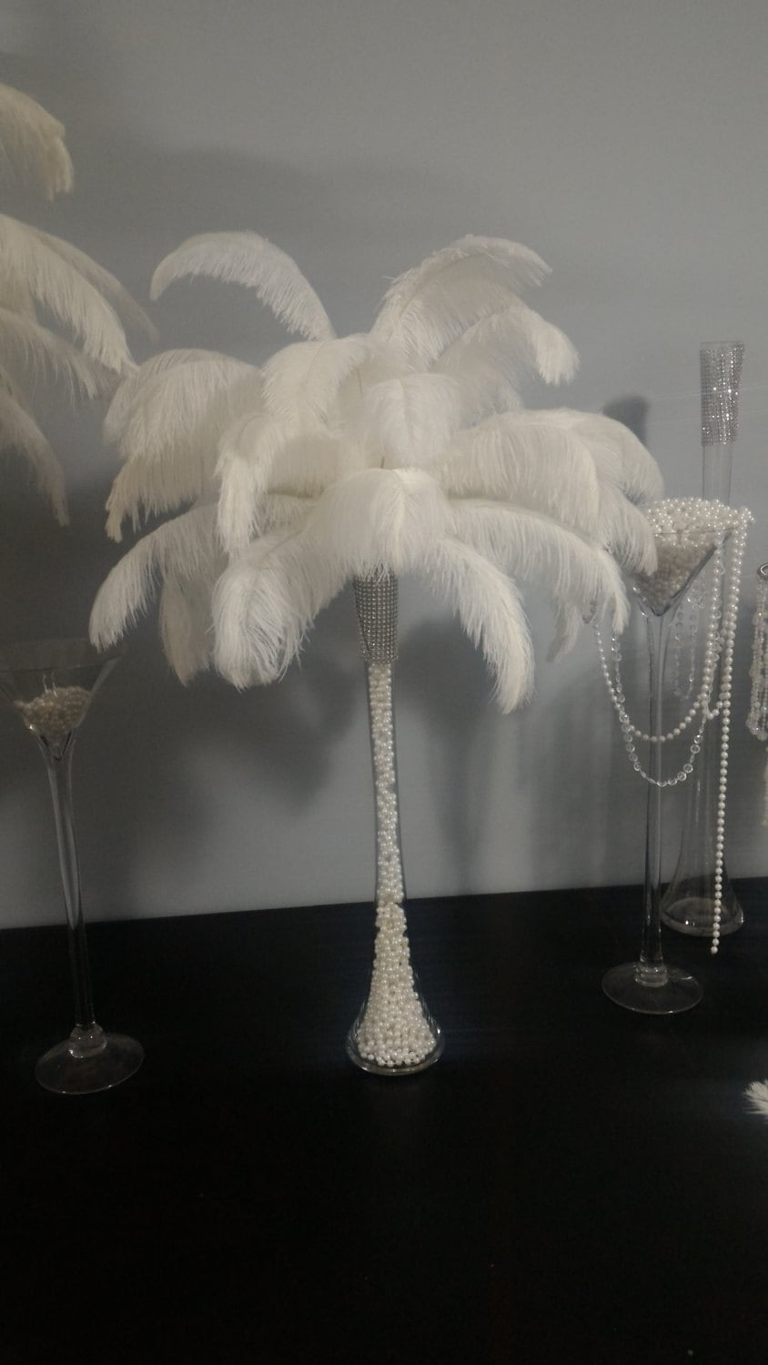 Ostrich feather centerpiece with pearls inside eiffel tower
