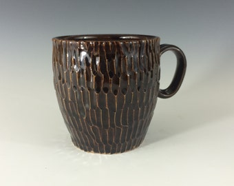 Textured dark brown handmade ceramic coffee mug