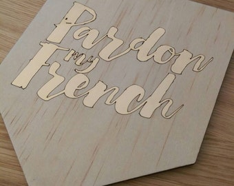 Timber wall art. Pardon my French. Timber wall art with gold foil design.