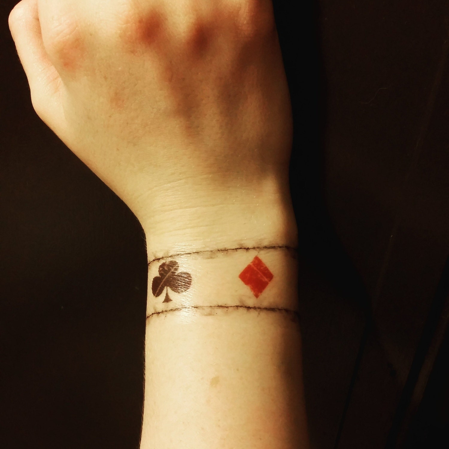one direction inspired playing card wrist tattoo louis
