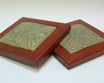 2 Tile Trivets, Ovate leaf pattern/wood framed green glaze