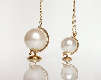 It's a Small World After All - Medium Globe Pearl Necklace - Brass Edition by TO+WN DESIGN , a popular graduation gift