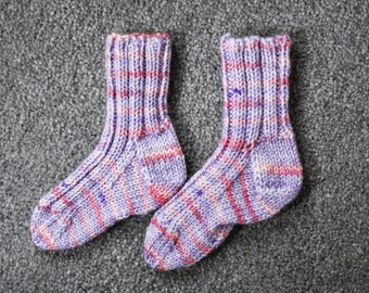 Handknitted newborn socks