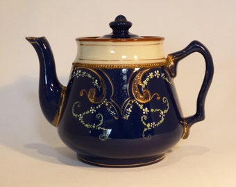 Blue & cream earthenware teapot with ornate hand painted pattern - unidentified maker/age