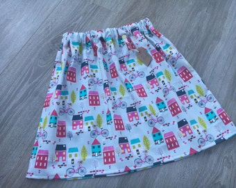 Girls Handmade Skirt grey. pink, turquoise houses and bicycles print fabric Age 7-8