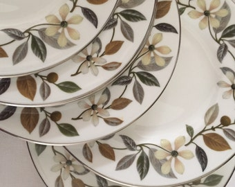 A set of six vintage side plates Beaconsfield by Wedgewood .