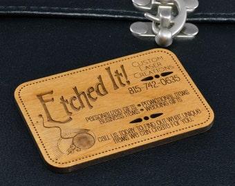 Custom designed 1/8 in thick alder wood business cards.