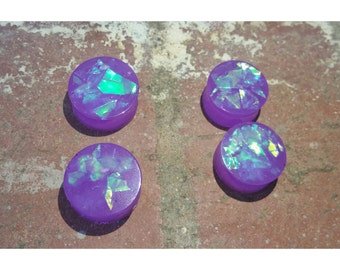 Purple plugs with glitter