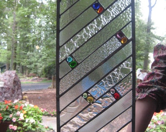 Clearly textured stained glass panel window with colorful glass nugget accents