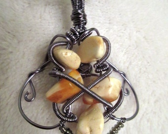 Smoked  silver  wire wrapped pendant with amber.