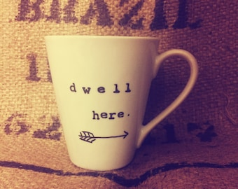 Dwell here COFFEE CUP