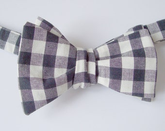 Mens Bow Tie. A Freestyle, Self Tie Bowtie in a  Black and White Checked Cotton Fabric.  Shipping Worldwide.