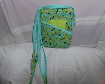Quilted, cross body zippered handbag