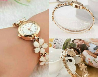 Watch jewelry in flowers